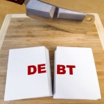 Debt-cut-in-half-on-choppong-board-150x150